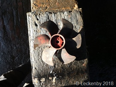 The bow thruster prop out in the sunlight